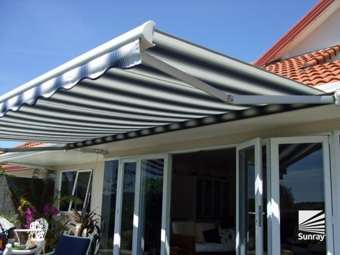 Felicia awning open and shading the homes deck
